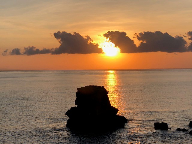 Sunset by the Indonesian coastline