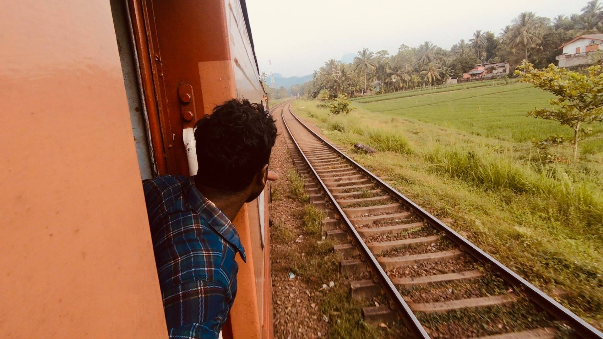 Riding the train in Sri Lanka.